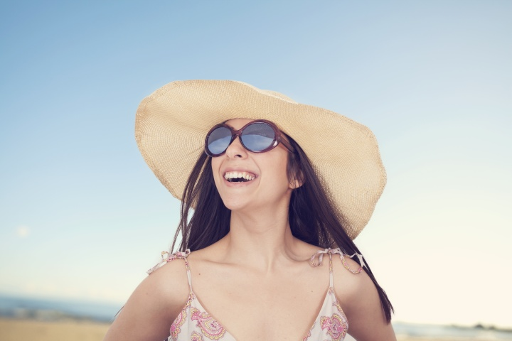 Portrait of beautiful woman in hat on summer vacation